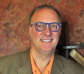 Tom Barracato licensed Akron optician